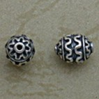 Raised Swirl Motif Oval Bead