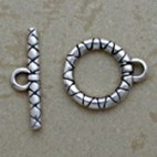 Silver toggle with yarn design